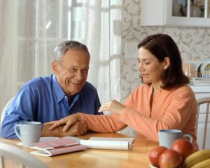 Gentleman receiving advice on in-home care from home health care consultant.